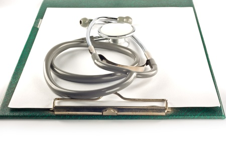 Stethoscope and clipboard isolated on white background Stock Photo - 9536028