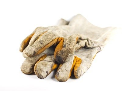 Dirty old leather gloves isolated on white background