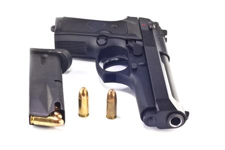9 mm.beretta gun and magazine isolated on white background Stock Photo - 9908351