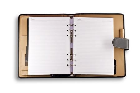 calendario escolar: Nota libro con portada aislada sobre fondo blanco Foto de archivo