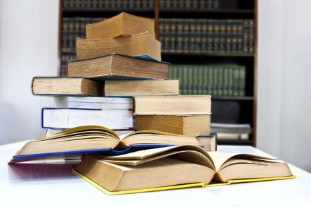 Pile of books in library with clipping path photo