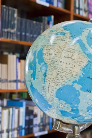 blurr: Globe ball in library with blurr background Stock Photo