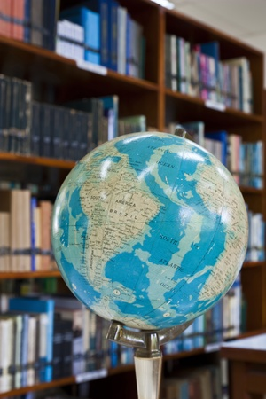 Globe ball in library with blurr background Stock Photo - 10194792