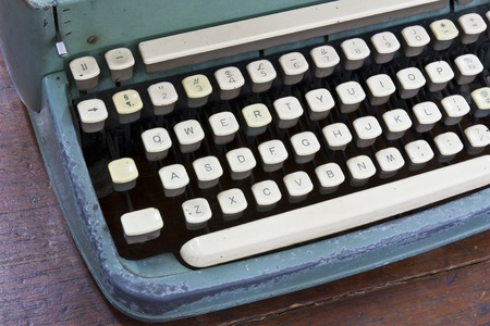 Old type device keyboard on old wooden table Stock Photo - 10365685