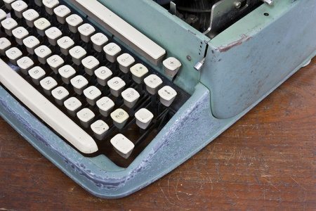 Old type device keyboard on old wooden table photo