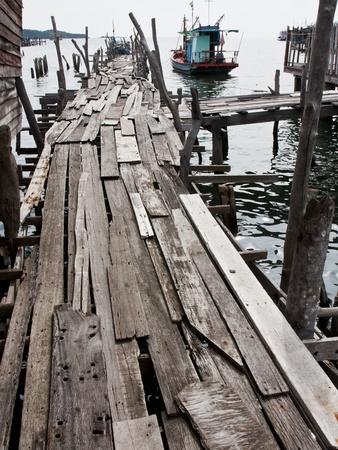 skipper: Old wooden fishing bridge to the sea Stock Photo