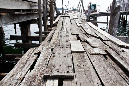 Old wooden fishing bridge to the sea photo