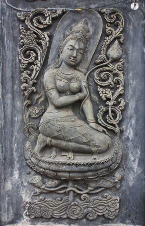 Thai stucco on Buddha temple wall photo
