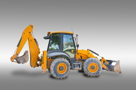 mini loader: Tractor isolated on gray background with clipping path