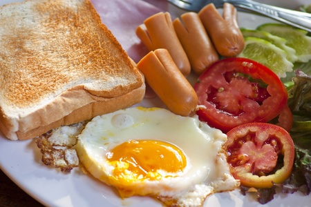 british food: Sausage,fried eggs,toast,tomato,breakfast American style Stock Photo