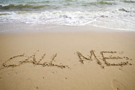 Message on beach with word call me photo