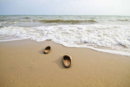 Sandle on beach with wide angle photo