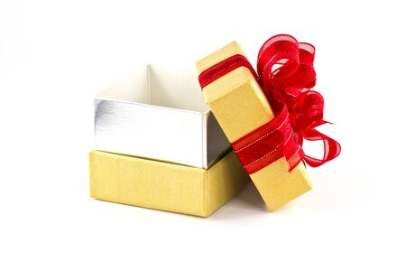 Opened gift box and red ribbon on white background photo
