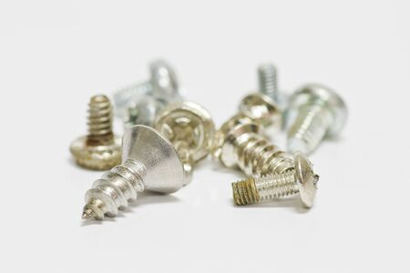 Little screws on white background with shallow focus Stock Photo - 13797744