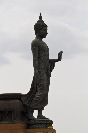 revere: Walking Buddha image in Thailand