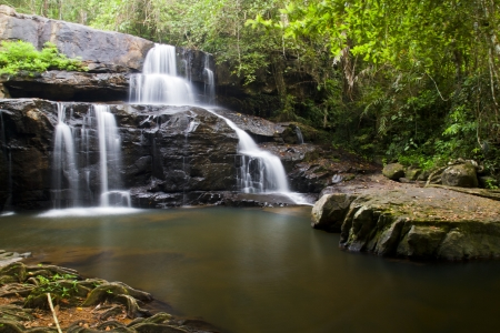 Waterfall in rain forest with slow shutter speed photo