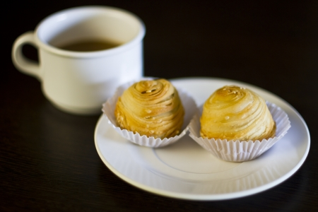 Snack and coffee on brown wood with shallow focus Stock Photo - 17098056