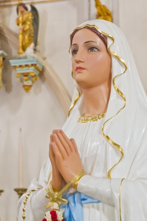 blessed: Sculpture of Mary in church