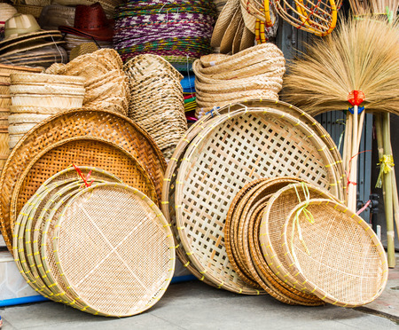 craft material: A pile of hand made wicker baskets in  a shop