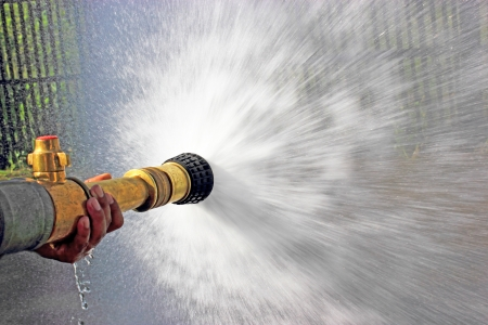 hoses: Firefighter fighting For A Fire Attack, During A Training Exercise Stock Photo