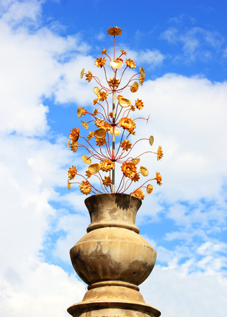 stoneware: Old flowerpot with ornament and golden flower  Stock Photo