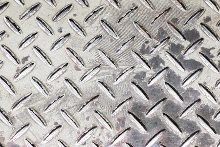 diamondplate: Background of metal diamond plate in silver color.