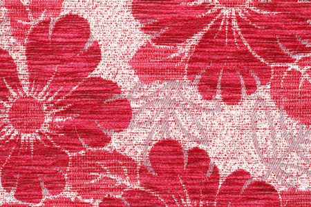 Fragment of colorful retro tapestry textile pattern with floral background photo