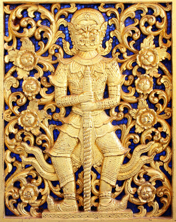 Ancient golden carving wooden window of Thai temple ; Vintage Thai style wood craft photo