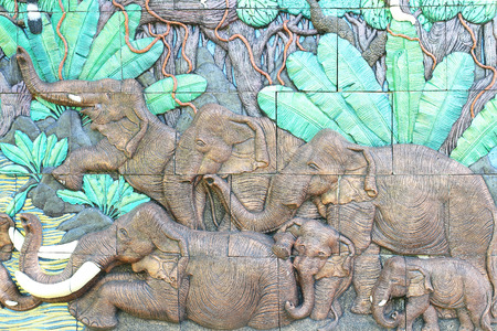 low relief: Low relief cement Thai style handcraft of elephant