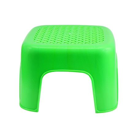 stool: Mini green plastic stool on white background Stock Photo