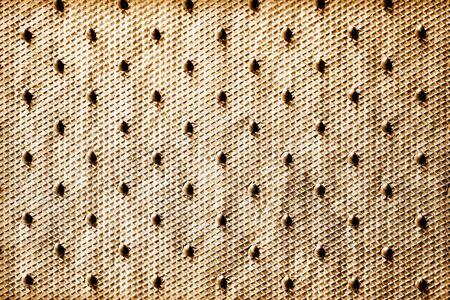 orifice: brown dot background