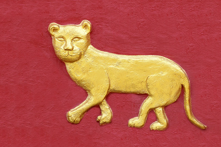 Golden Tiger sculptures on the wall photo