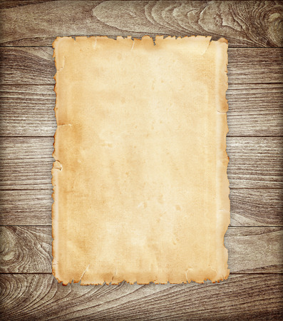 wooden surface: Old paper on wood background.