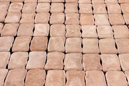 interlocking: Brick sidewalk, made from plain interlocking concrete bricks Stock Photo