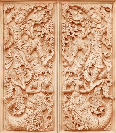 places of worship: Wood carving Buddhist temple door public places of Buddhist worship. Stock Photo
