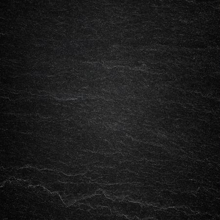 Oscuro fondo de pizarra gris negro o la textura de la piedra natural. Foto de archivo