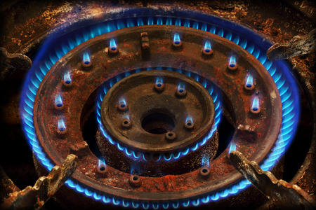 energetically: Blue flames of gas burning from a kitchen gas stove
