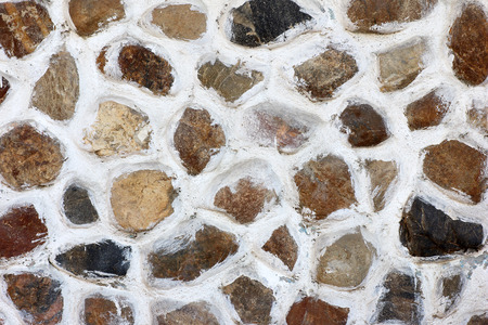 pebblestone: walls decorated with stone background Stock Photo