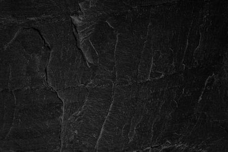 暗い灰色黒いスレート背景や自然石のテクスチャ。 写真素材