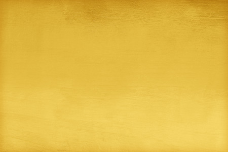 concrete gold painted texture abstract for background, shiny yellow gold texture background 免版税图像
