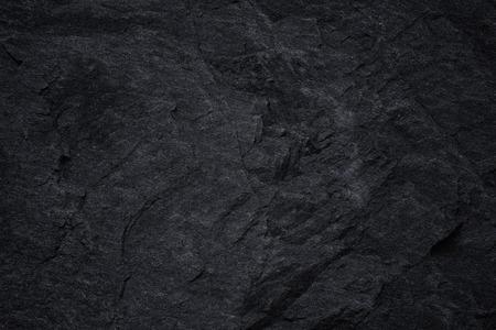 Fond d'ardoise noire gris foncé ou texture de pierre noire naturelle. Abstrait