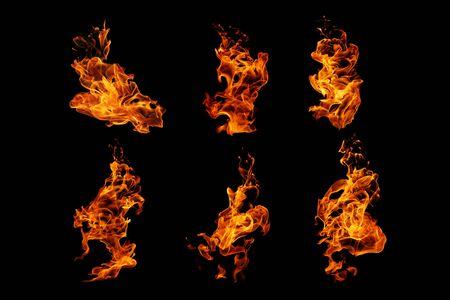 Collezione di fiamme di fuoco isolata su sfondo nero, movimento di fiamme di fuoco sfondo astratto Archivio Fotografico