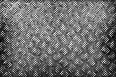Aluminum dark plate texture with diamond pattern background