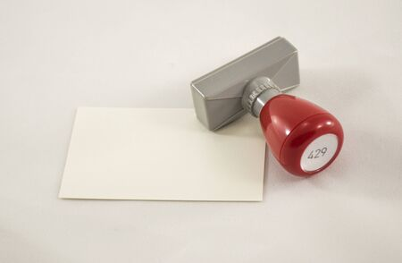 validate: Stamper and a piece of paper Stock Photo
