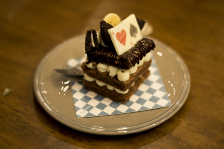 layered: Layered cake decorated with heart and spade on wooden table