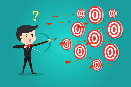 A successful businessman aiming target with bow and arrow/Can not decide which target to shoot at.