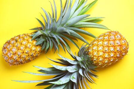pineapple with yellow background. summer fruit concept.