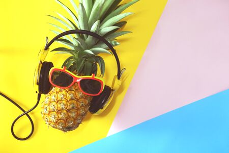 pineapple with glasses. summer fruit concept.