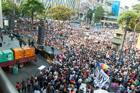 shutdown: BANGKOK THAILAND - FEBRUARY 2 : Unidentified protesters gather Ratchaprasong intersection to anti government and not voting in the day of the election under the concept of Bangkok shutdown on Feb 2, 2014 in Bangkok, Thailand.