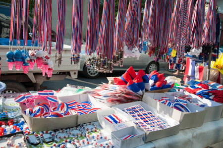tricoloured: BANGKOK THAILAND - FEBRUARY 2 : Whistles and national flag tri-coloured ribbons, Tools andor souvenirs of Bangkok Shutdown protest. At Ratchaprasong intersection on Feb 2, 2014.